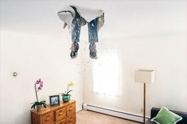 diy-disaster-photo-of-mans-legs-through-ceiling